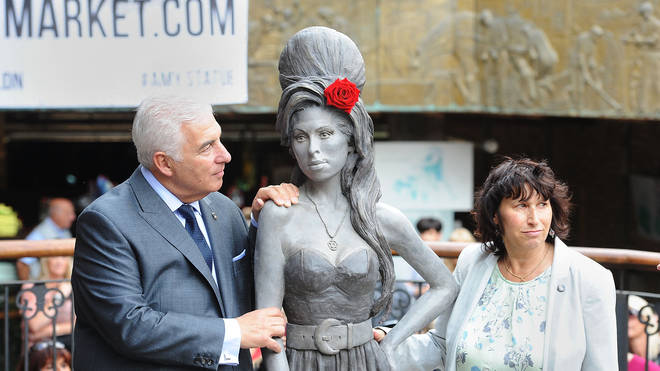 Mitch and Janis Winehouse unveiling daughter Amy's statue in 2014