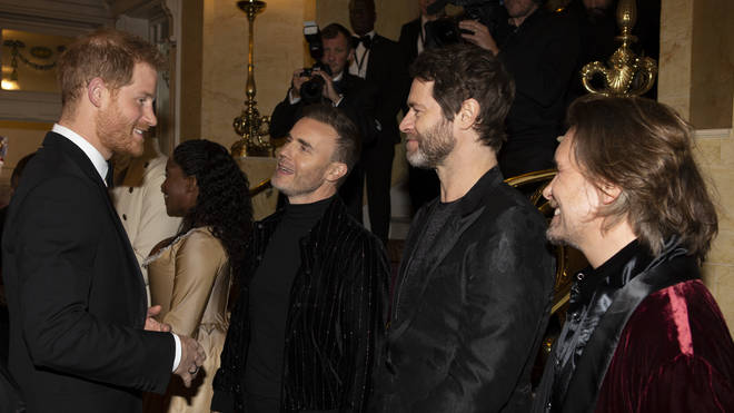 Harry with Take That