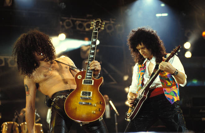 Slash & Brian May performing on stage at the Freddie Mercury Tribute concert  (Photo by Mick Hutson/Redferns)