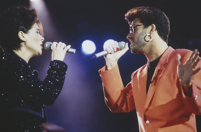 Lisa Stansfield and George Michael performing at the Freddie Mercury Tribute Concert for AIDS Awareness, at Wembley Stadium, London, 20 April 1992. (Photo by Mick Hutson/Redferns/Getty Images)