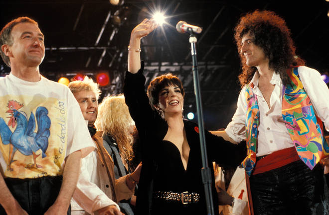 John Deacon, Roger Taylor, Liza Minelli, Brian May performing on stage at the Freddie Mercury Tribute concert (Photo by Mick Hutson/Redferns)