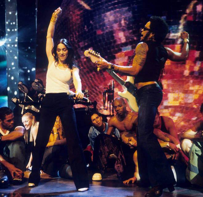 Madonna and Lenny Kravitz performing at MTV Video Music Awards in 1998. (Photo by Ke.Mazur/WireImage)