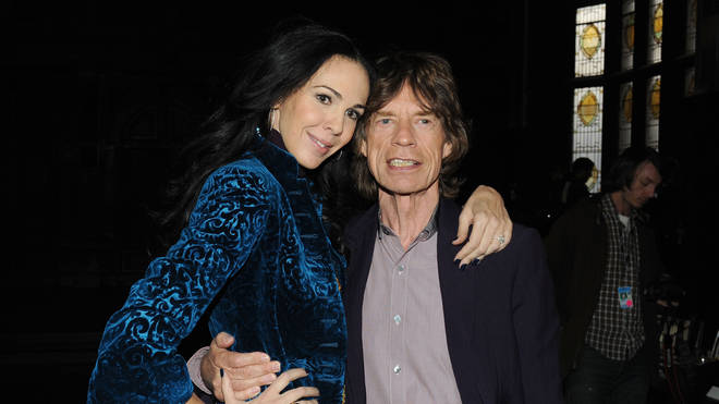 Mick Jagger and designer L'Wren Scott at the L'Wren Scott Fall 2012 fashion show on February 16, 2012 in New York City. (Photo by Slaven Vlasic/Getty Images)