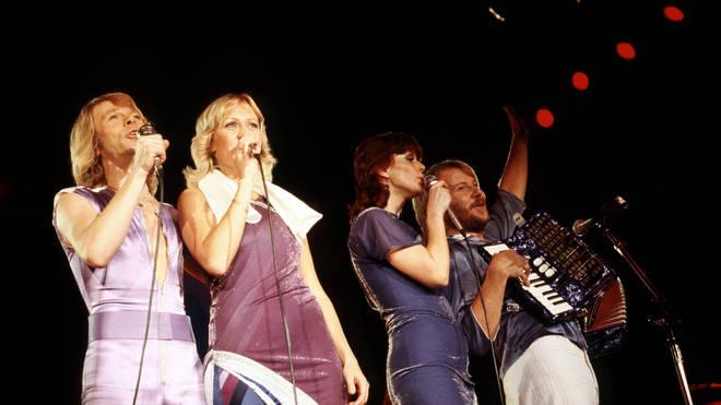 ABBA, L-R: Bjorn Ulvaeus, Agnetha Faltskog, Anni-Frid Lyngstad, Benny Andersson performing together at Wembley Arena, November 1979. (Photo by David Redfern/Redferns)