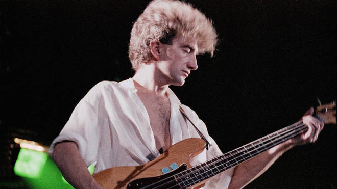 Queen bassist John Deacon performing live on stage at Wembley Arena. (Photo by Phil Dent/Redferns)