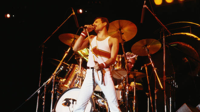 Freddie Mercury on stage during a live concert at the National Bowl in Milton Keynes, 1982. (Photo by Fox Photos/Hulton Archive/Getty Images)