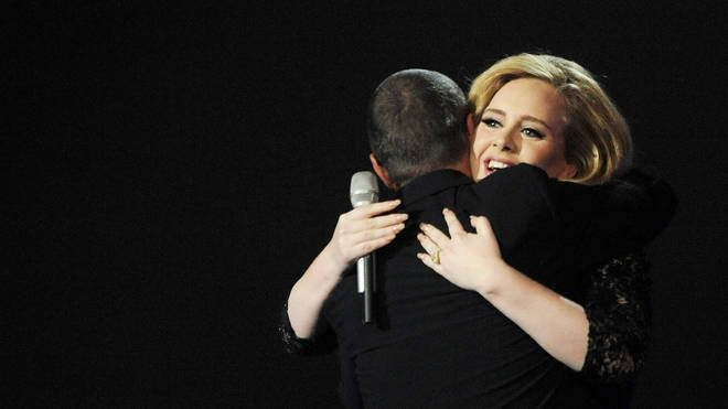 George Michael warmly embraces Adele after she wins Best Album at the BRIT Awards in 2012. (Photo by Dave M. Benett/Getty Images)