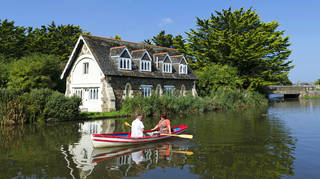 On a still day in spring, summer, or autumn, taking out a rowing boat is a great way to both absorb the countryside and get to know someone. (Photo by:  Education Images/Universal Images Group via Getty Images