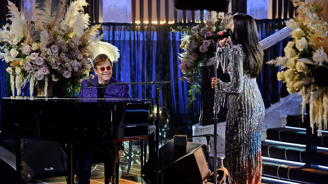 Elton John performing friend and collaborator Dua Lipa at the AIDS Foundation Academy Awards on April 25, 2021. (Photo by David M. Benett/Getty Images for the Elton John AIDS Foundation)