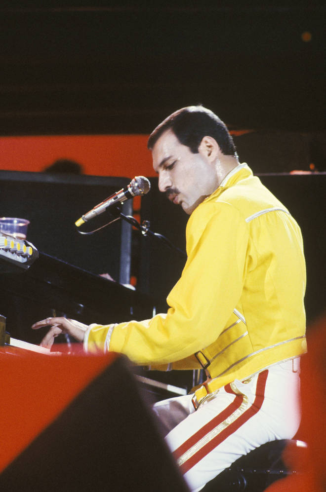 Freddie Mercury of Queen playing piano while performing on stage on the Magic Tour at Wembley Stadium, London, July 1986. (Photo by Suzie Gibbons/Redferns)