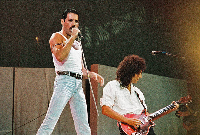 Queen's Freddie Mercury and Brian May during their legendary Live Aid set at Wembley Stadium on July 13th, 1985. (Photo by Pete Still/Redferns)