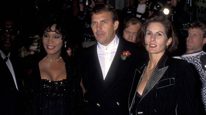 Whitney Houston, Kevin Costner and his wife Cindy Costner attend The Bodyguard Premiere in Hollywood, California. (Photo by Ron Galella, Ltd./Ron Galella Collection via Getty Images)