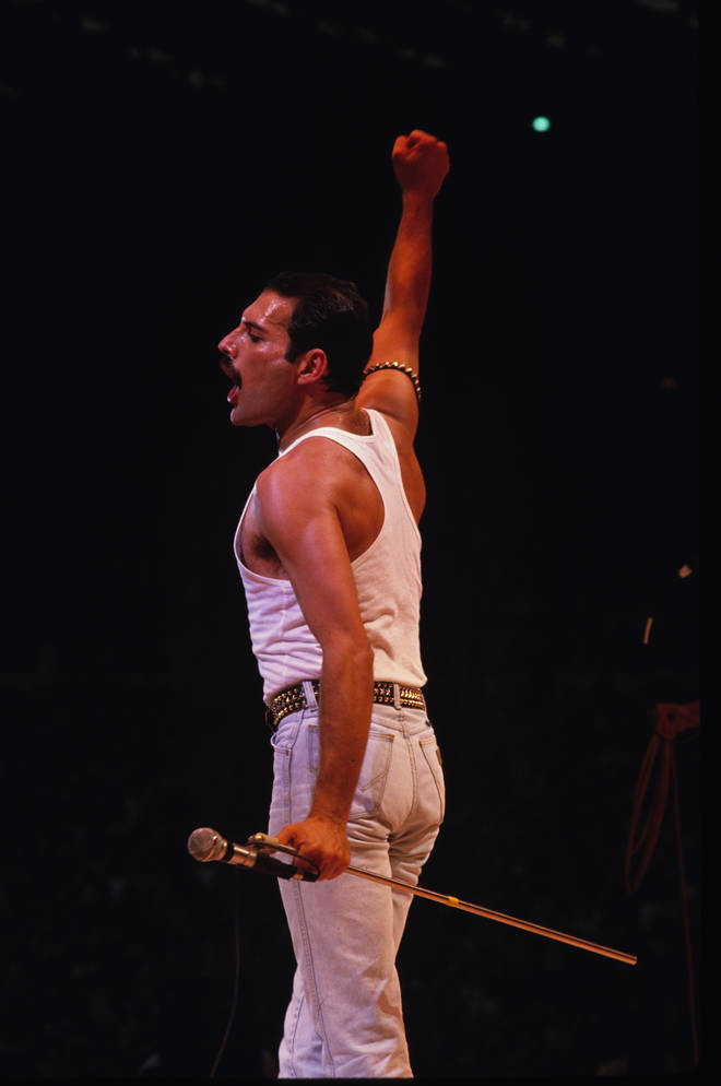 Freddie commanding the 80,000 strong crowd at Wembley Stadium during their Live Aid set.