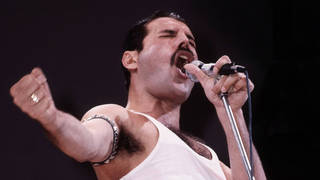 Freddie Mercury of Queen performs on stage at Live Aid at Wembley Stadium, 1985. (Photo by Phil Dent/Redferns)