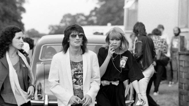 Ronnie Wood with his ex-wife Jo Wood at Knebworth Pop Festival, 1979. (Photo by Mirrorpix/Mirrorpix via Getty Images)