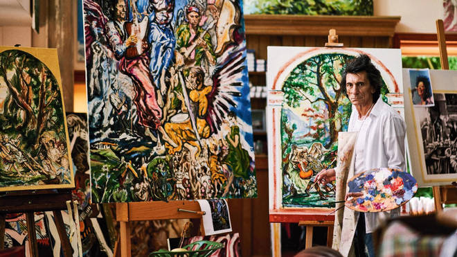 Ronnie Wood painting in his art studio. (Photo by Julian Broad.)