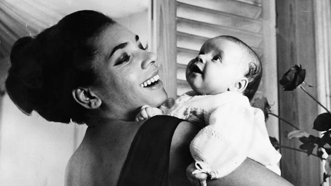 Shirley Bassey holding her daughter Samantha at 10-weeks old. (Photo by Daily Express/Archive Photos/Hulton Archive/Getty Images)