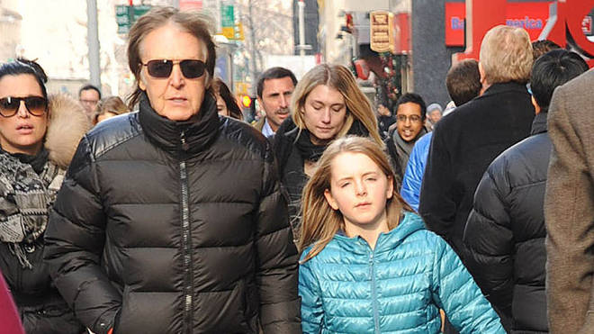 Sir Paul McCartney and his daughter, Beatrice McCartney, are seen on December 19, 2013 in New York City. (Photo by Demis Maryannakis/Star Max/FilmMagic)
