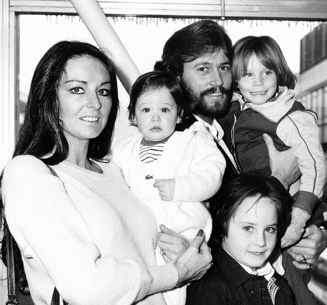 Barry Gibb and wife Linda Gray with their three sons in 1982