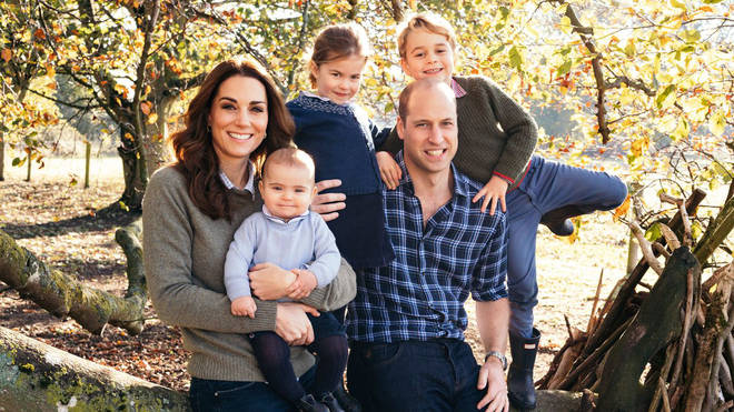 The Duke and Duchess of Cambridge and their three children Prince George, Princess Charlotte and Prince Louis pose among the autumn leaves