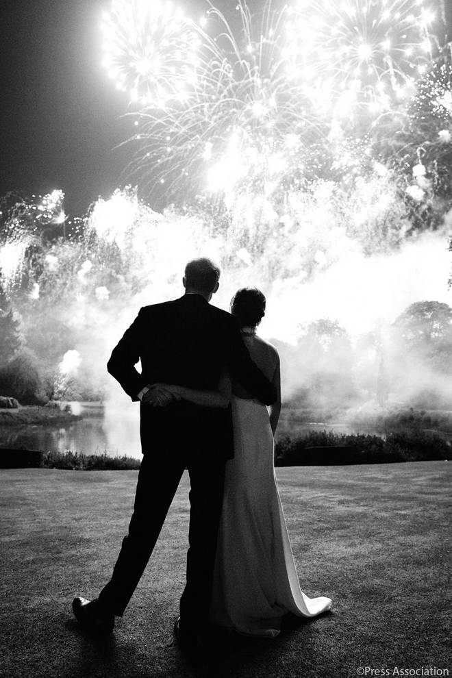 Prince Harry and Meghan Markle, the Duke and Duchess of Sussex look ahead at fireworks in Windsor