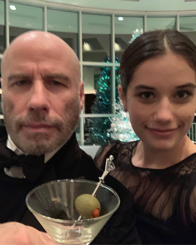 John Travolta shows off his new bald look
