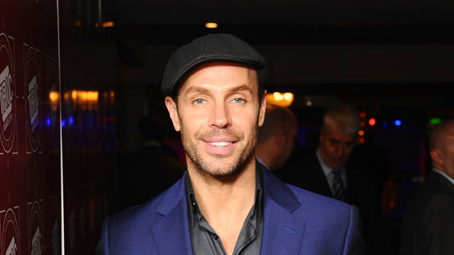 Jason Gardiner throwback picture as he poses in blue suit
