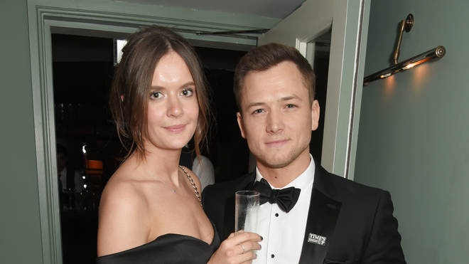 Taron Egerton and Emily Thomas in 2018