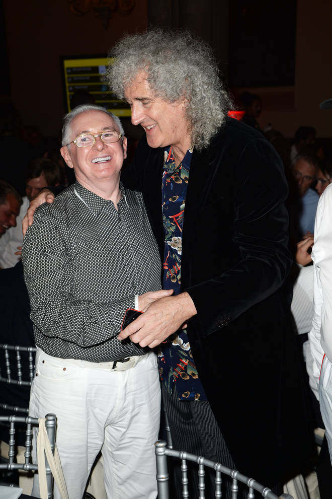 John Reid and Brian May in 2013