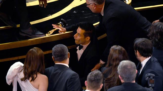 Rami Malek takes a tumble at the Oscars