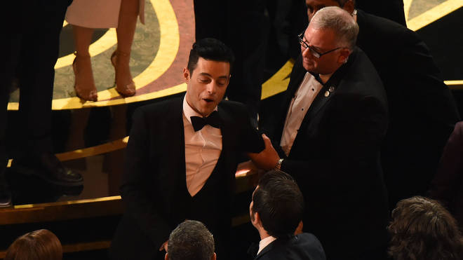 Rami Malek laughs off his on-stage fall at the Oscars