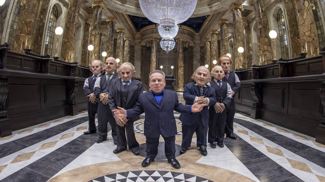 Warwick Davis (C) and Goblins in the original Gringotts...