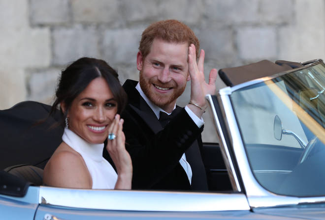 Harry and Meghan on the way to their wedding reception
