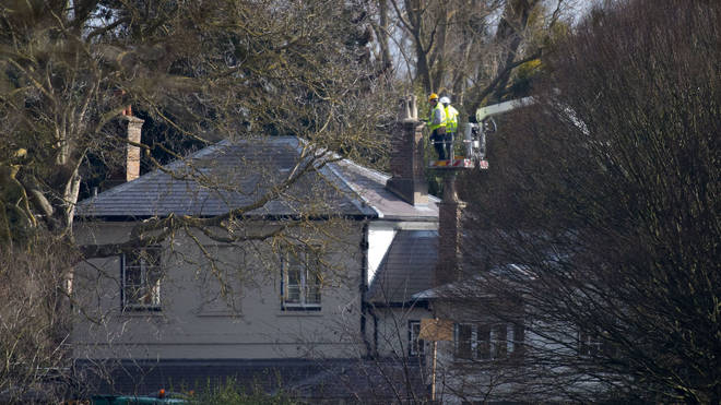Builders working on the chimney's of Frogmore Cottage