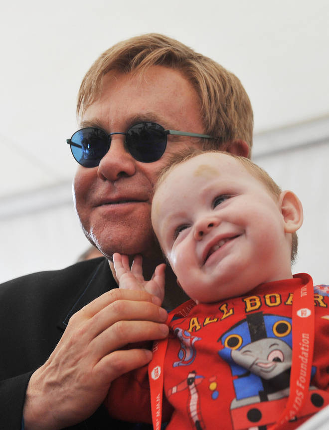 Elton John pictured with orphan Lev in 2009