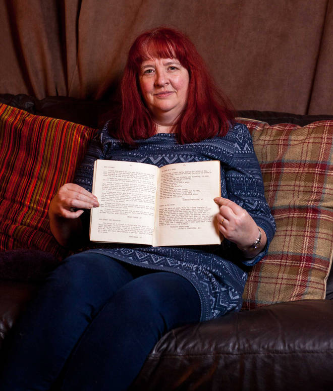 Penny Ling poses with the schoolbook she unearthed containing George Michael's poems