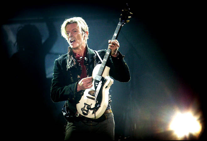 Rock legend David Bowie performs on stage