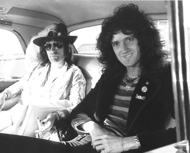 Freddie Mercury and Brian May in the back of a car, 1974