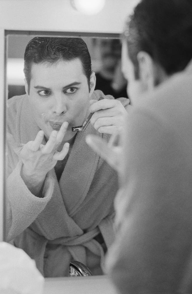 Th Queen frontman shaving his moustache backstage on April 12, 1984