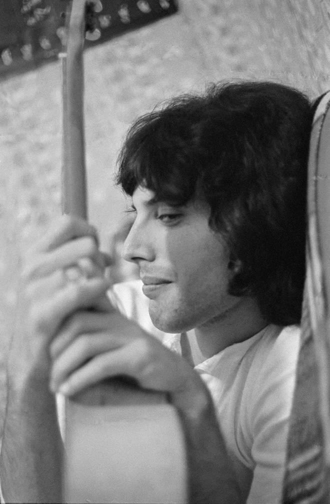 Freddie Mercury pictured relaxing at his Shepherd's Bush, London flat in 1969