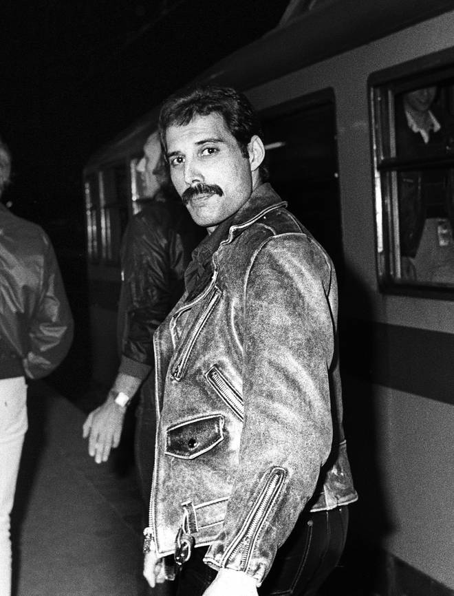 Freddie Mercury getting a train from Leiden to Amsterdam, Netherlands, after a gig at Groenoordhal, Leiden, 25th April 1982.