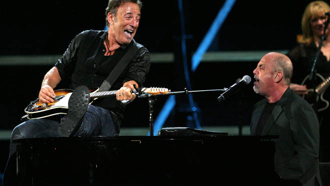 Bruce Springsteen and Billy Joel perform onstage on October 29, 2009 in New York City