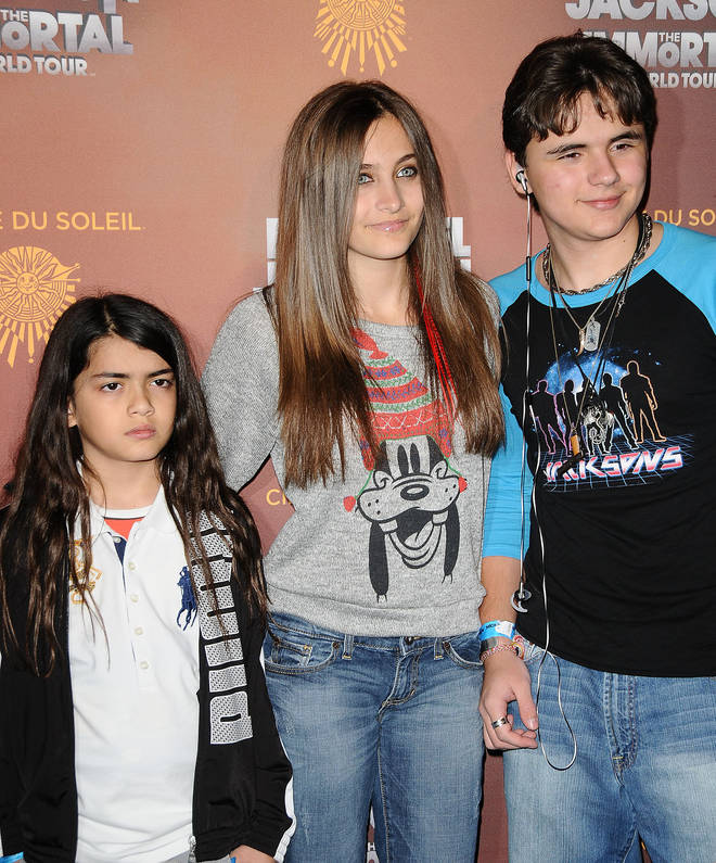 "Blanket Jackson, Paris Jackson and Prince Michael Jackson attend the Los Angeles opening of ""Michael Jackson THE IMMORTAL World Tour"" on January 27, 2012 in Los Angeles, California"