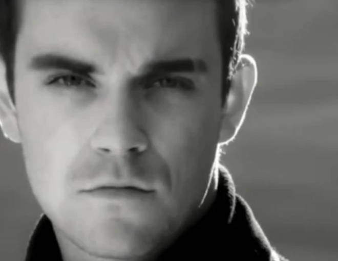 Robbie Williams has revealed his hit song 'Angels' was written about supernatural encounters