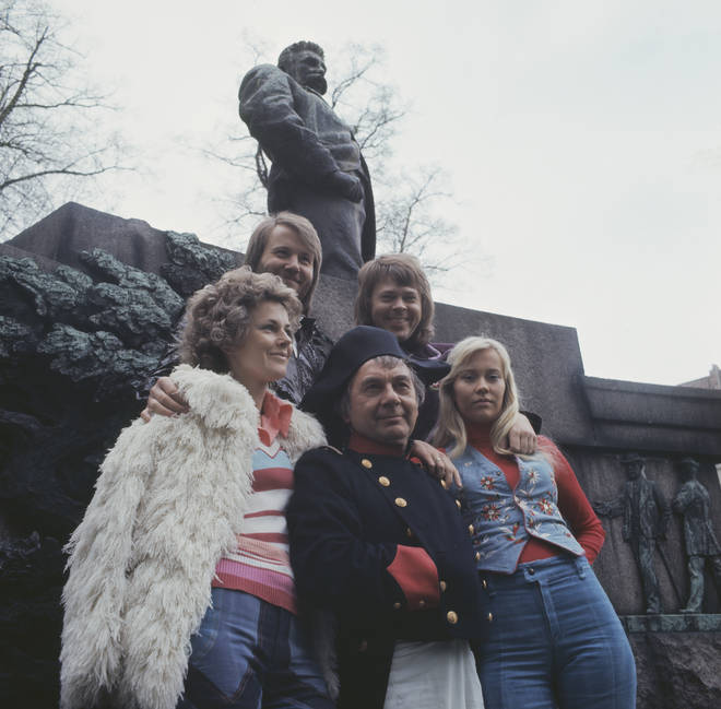 An actor dressed as Napoleon Bonaparte poses with ABBA to promote 'Waterloo' in Copenhagen, Denmark in 1974.