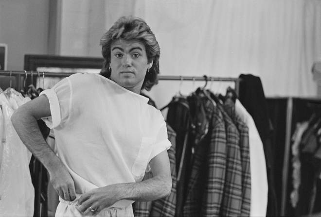 George Michael pictured changing in to his stage clothes backstage during the Australian leg of Wham!'s 1985 world tour, January 1985.