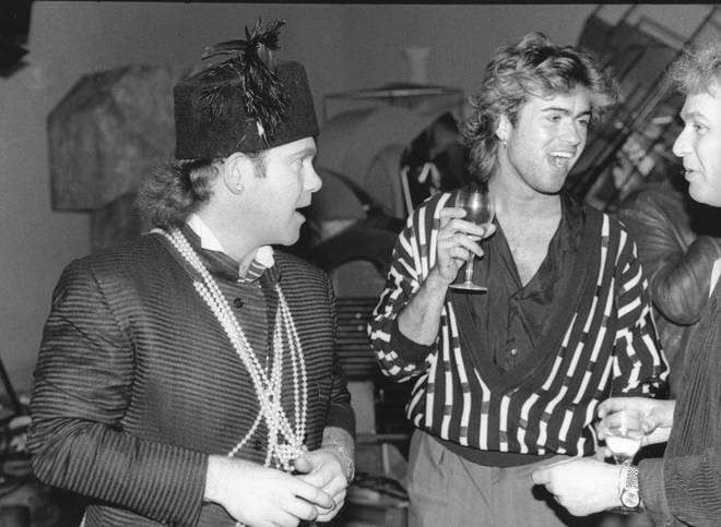 Elton John and George Michael chat in a film studio in May 1985 in London, England.