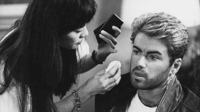 George Michael pictured receiving attention from a make up artist prior to appearing at a press conference during the Japanese/Australasian leg of his Faith World Tour, February-March 1988.