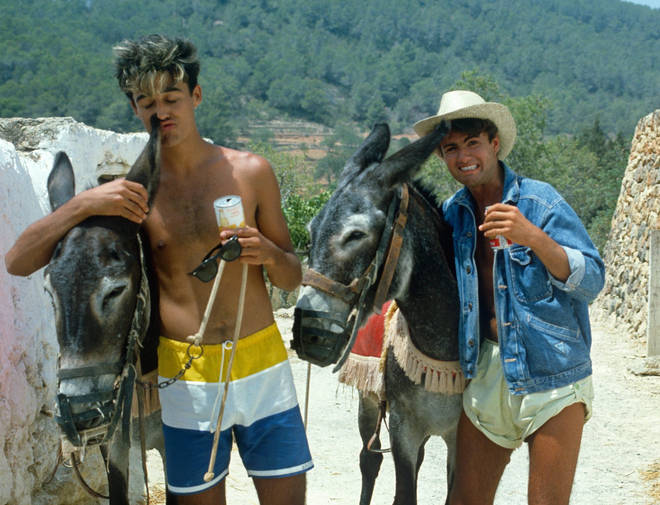 George Michael and Andrew Ridgeley riding donkeys while in Ibizia to record of Club Tropicana at Pikes Hotel in Ibiza on March 16, 1983 in Ibiza, Spain.