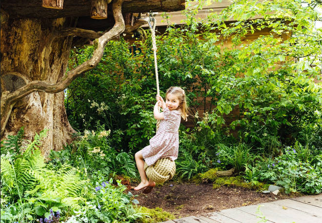 The children take turns to play on the outdoor swing